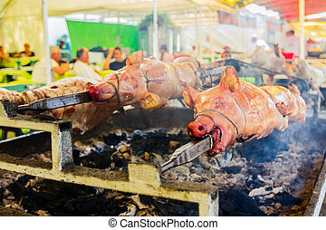 Roasting pig - Meat on the spit; delicious roasted meat...