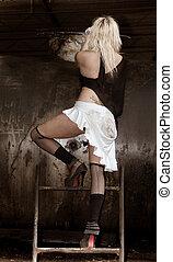 The scrapyard - Beautiful model posing in dirty scrapyard
