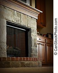 Fireplace Mantel - Stone and brick fireplace with wooden...