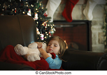 Christmas Morning - A little girl sleeps in anticipation for...