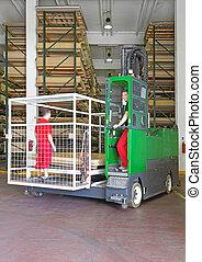 Side loader forklift for the material handling industry