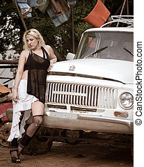 The scrapyard - Beautiful model posing in dirty scrapyard