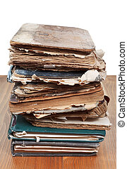 stack antique books on wooden table