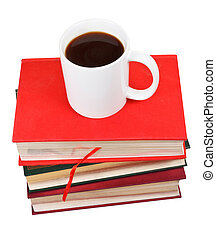 cup of coffee on stack of books