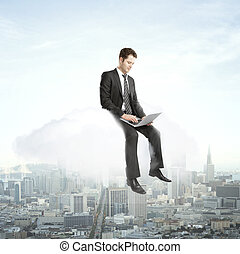 man sitting on a cloud with laptop