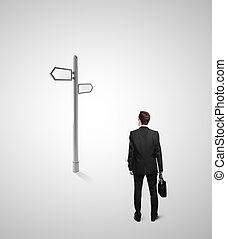 direction indicator - businessman looking at direction...