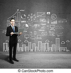 businessman with laptop - man with laptop and business plan...