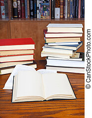 open books on wooden table