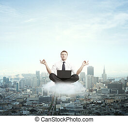 businessman meditating on a cloud
