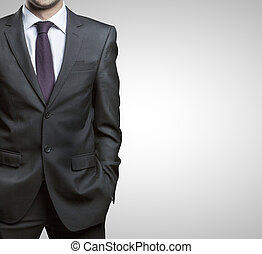 man in suit - businessman in suit on a gray background