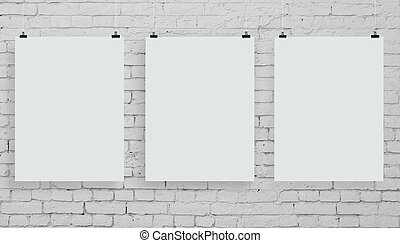 three poster - brick wall with three white poster