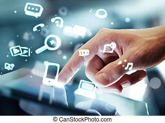 social media concept - hand touching digital tablet, social...