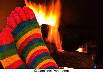 toe socks by fire - Striped toe sock warming by the...