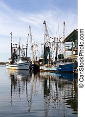 Docked Shrimp Boats - Two old rusty shrimp boats are docked...