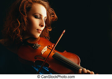 beautiful violinist playing violin