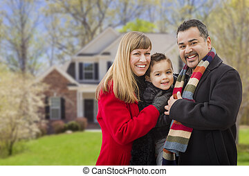 Happy Mixed Race Family in Front of House