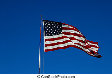 us flag windy - windy day clear blue skies with American...