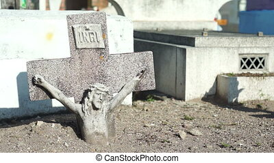 Jesus Cross Buried Dolly - A dolly shot of a statue of jesus...