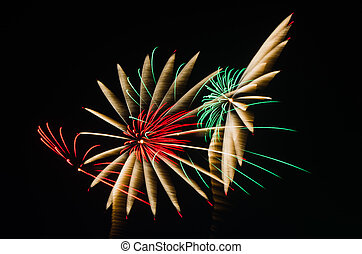 An image of exploding fireworks at night Represents a...