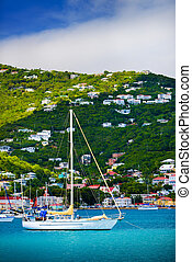 Sailboats anchored in St. Thomas Harbor, Caribbean.