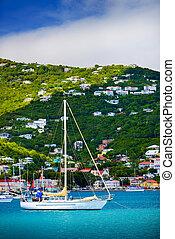 Sailboats anchored in St. Thomas Harbor, Caribbean.