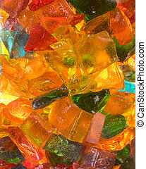 Hard rock candy in glass jar with light shining through