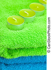 a few candles lying on the towel