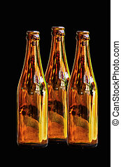 Brown glass bottles - Emty brown glass bottles on black...