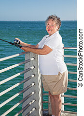Senior Fishing Fun - Senior lady having a great time fishing...