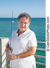 Senior Woman Loves Fishing - Portrait of beautiful senior...