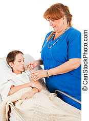Nurse Administers Fluids - Nurse gets a young patient to...