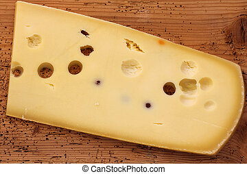 Big Emmental Cheese Emmentaler from Switzerland on a wooden...