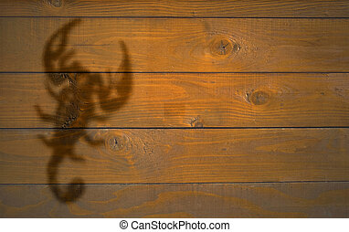 Scorpio - sign of Scorpio on the wooden texture suitable for...
