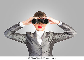 business woman looking through binoculars, looking for a...