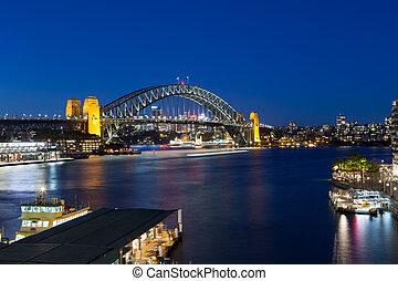 Sydney Harbour Bridge at Dusk - Boat traffic around Sydney...