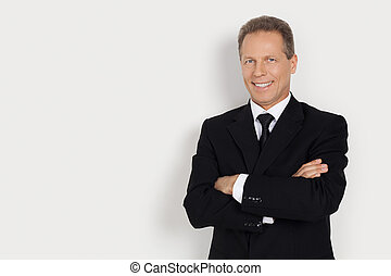 Confident businessman Cheerful mature man in formalwear...