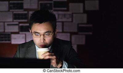 Long Hours - Businessman drinking coffee to overcome...