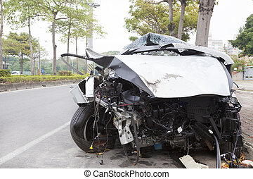 wrecked car on the road