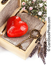 red heart with key in retro box isolated on white background