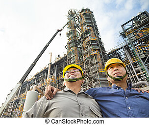 two Factory workers standing together