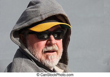 Geezer with Hoodie - Man with white beard wearing...