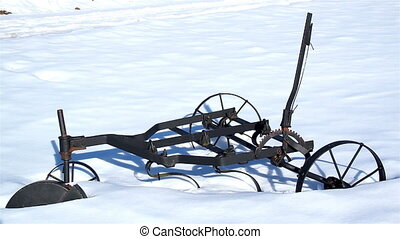 Old agri tool stuck on the snow - Unused old agri tool parts...