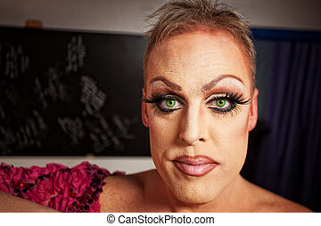 Close up of Man in Makeup - Serious man with makeup in...