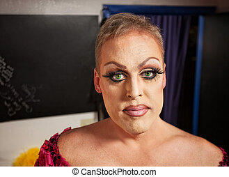 Drag Queen in Dressing Room - Close up of man with makeup in...
