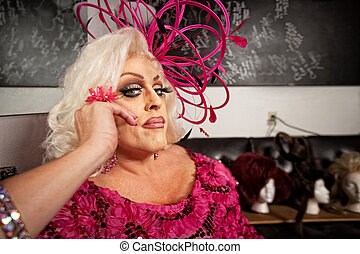 Serious Man in Drag - Serious man in blond wig and pink...
