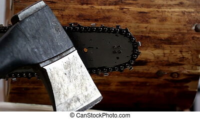 An axe and a chainsaw together