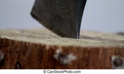 The tip on an axe pinch on the wood - The tip on an black...