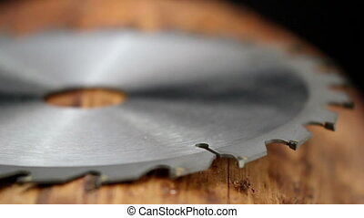 Side view of a metal blade of a saw with shar edges use for...