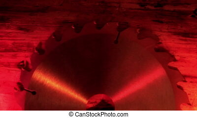 A blade saw under a red-lighted room - A blade saw with...