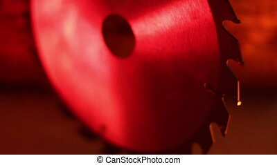Front view of a saw blade under red-lighted room - Front...